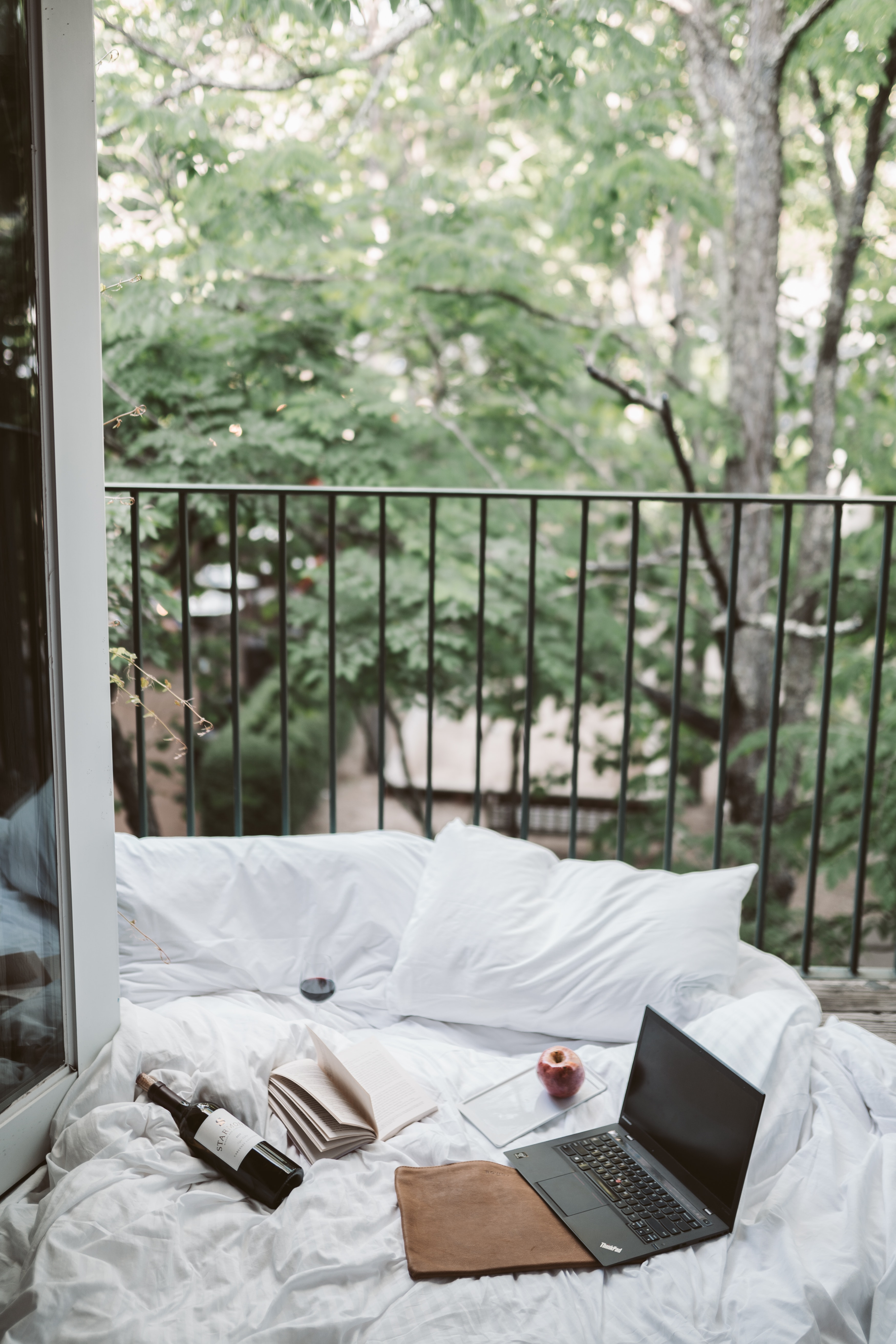 laptop-on-bed-near-the-balcony-4099388